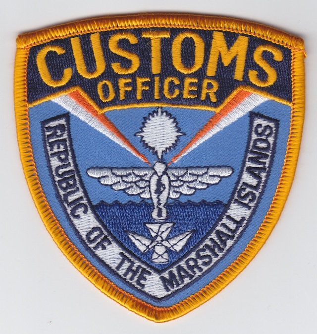 MH_001_Customs_Officer_Shoulder_Patch_left_Side